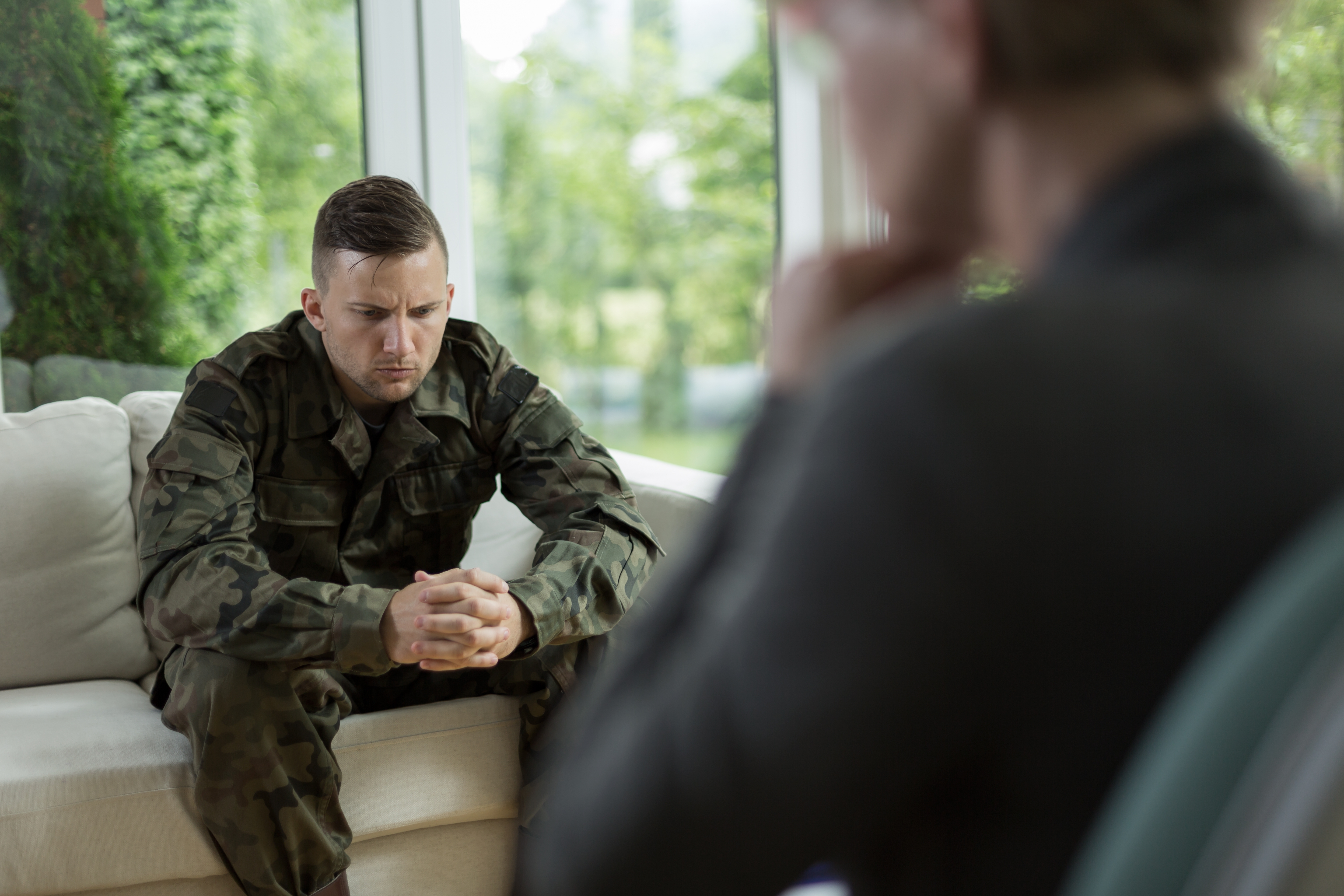 military person sitting in therapy